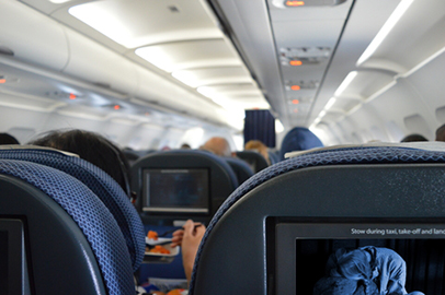 http://www.dreamstime.com/stock-photo-airplane-cabin-interior-passengers-entertainment-food-movie-image47528040